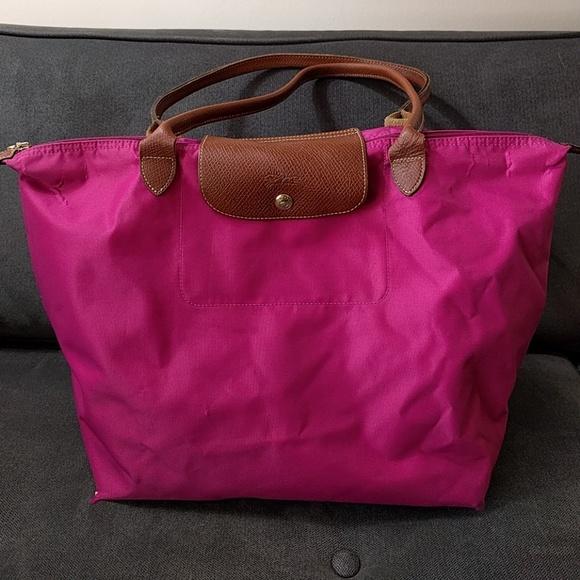 034e2f93d32e Longchamp hot pink pliage bag large AS IS. M 5b994af3bb7615ac3279121a